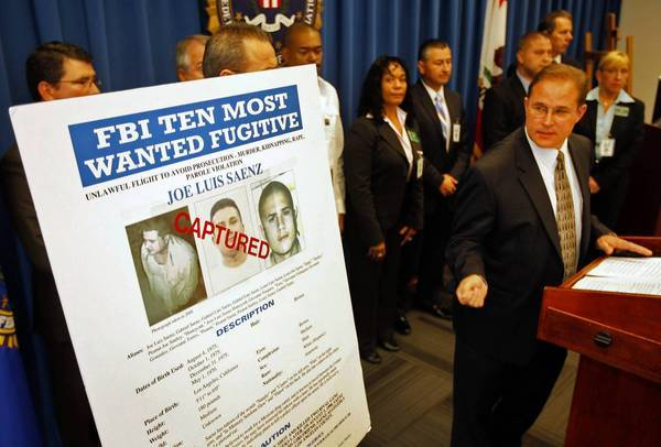 Bill Lewis, right, of the FBI's Los Angeles office speaks at a news conference about the arrest of Jose Luis Saenz.