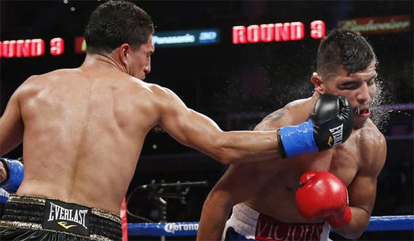 Josesito Lopez, left, delivers a punch to Victor Ortiz during the ninth round of a WBC welterweight boxing match in June.
