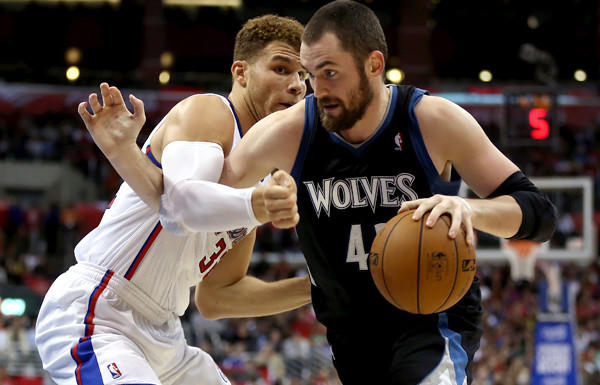 Timberwolves power forward Kevin Love tries to drive past Clippers power forward Blake Griffin in the first half Wednesday night at Staples Center.