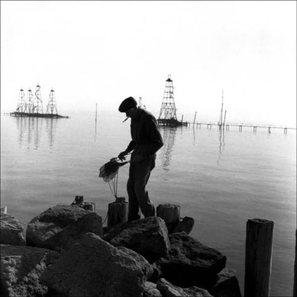 Fisherman with his nets. Bibi-Heybat oil village. Azerbaijan. 2006