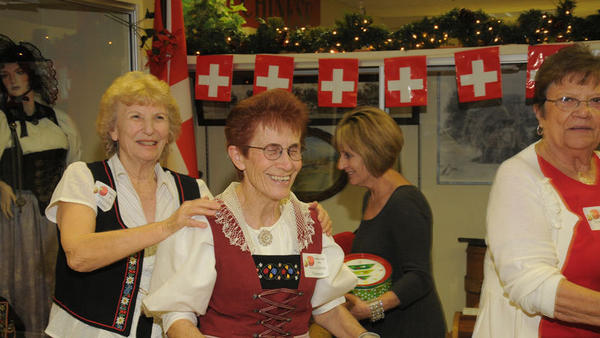 Swiss gallery volunteers smile during the 2011 Holiday Tour at Pioneers Museum.