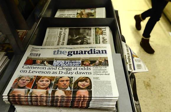 Newspapers are seen on sale at Victoria Station in central London