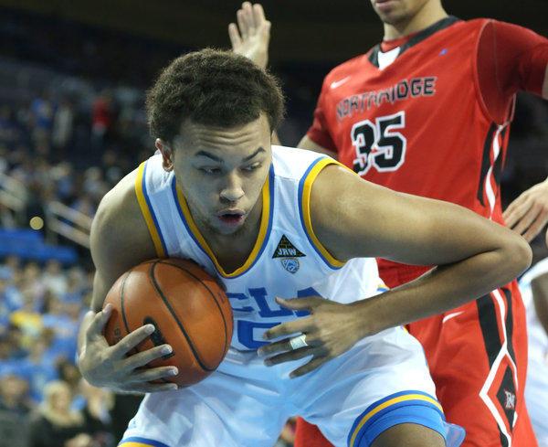 UCLA freshman Kyle Anderson pulls down a rebound against Cal State Northridge.