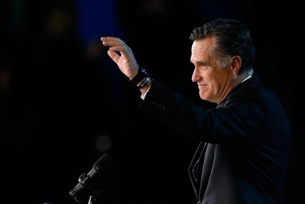 U.S. Republican presidential nominee Mitt Romney gestures as he gives his concession speech after losing the election to U.S. President Barack Obama, at Romney's election night rally in Boston, Massachusetts November 7, 2012.