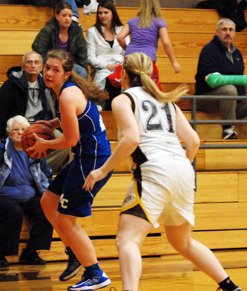 Mackinaw City's Claudia Alexander (left) looks for an opening on the baseline as Pellston's Alexis Stencel defends during Tuesday's non-league opener at the Pellston High School gym. Alexander had a team-high 15 points and eight rebounds as the Comets defeated the Hornets, 62-50.