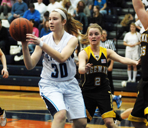 Petoskey senior guard Alyssa VanWerden (left) is among six returners to the lineup for second-year Northmen coach Adam Dobrowolski. The Northmen open the 2012-13 season against St. Ignace at 7:30 p.m. Friday, Nov. 30, at the annual Petoskey Girls Basketball Invitational at the Petoskey High School gym. The Saints are the defending tournament champions and finished 25-1 last season advancing to the Class C state semifinals, while Petoskey finished 14-10 overall and claimed the programs first-ever Class A district title.