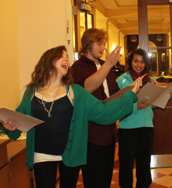 Members of a Petoskey District Library readers theater group (from left) Libby Barbercheck, Forrest Conway and Christina Dewey practice for a New Year's Eve community celebration.