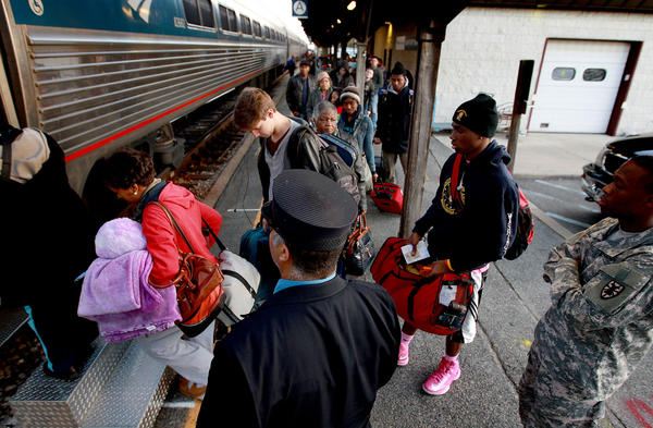 Passengers board an Amtrak train at the station in Newport News. Ridership in Newport News has been robust.