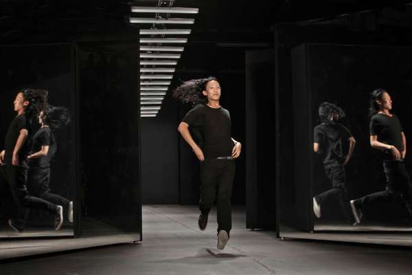 Fashion designer Alexander Wang takes a bow during New York Fashion Week.