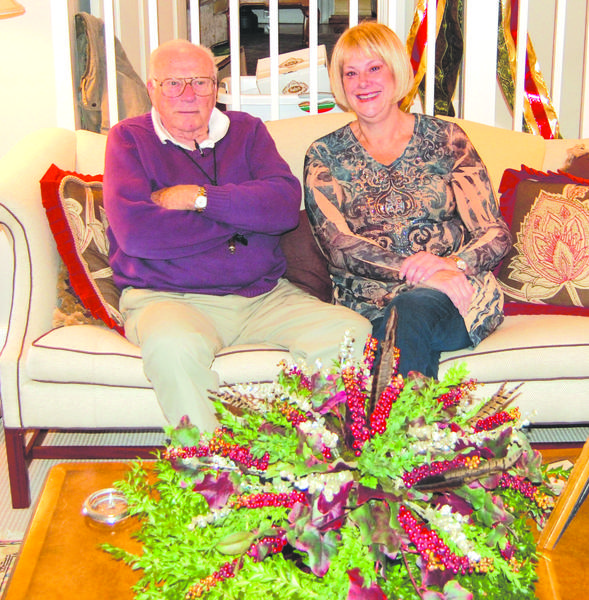 Father and daughter duo Joe and Mary Cynthia Martin are decorating a room at the Old Governor's Mansion in Frankfort. The holiday showcase will run Friday through Dec. 9.