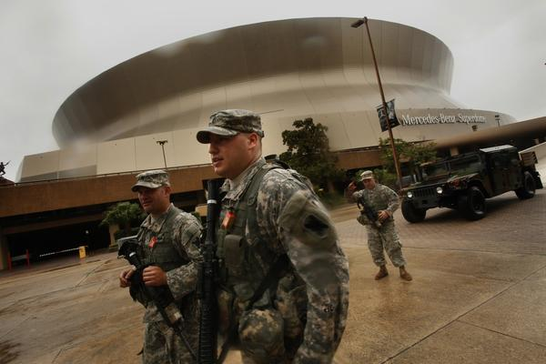 Members of the National Guard keep security at the New Orleans Superdome as Hurricane Isaac approaches within 20 miles.