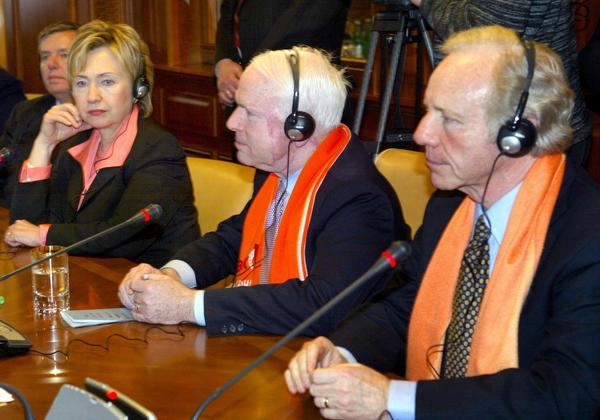US senator Hillary Clinton (L), US senator John McCain (C) and US Joseph Lieberman (R), listen to Presiden Viktor Yushchenko during their meeting in Kiev 11 February 2005. US Congress delegation headed by John McCain, arrived in Kiev  for a one-day official visit to meet with Ukraine's top officials.