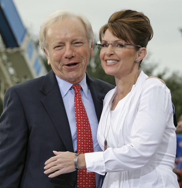2008 Republican vice-presidential candidate, Gov. Sarah Palin, right, gets a hug from  Sen. Joe Lieberman, I-Conn., before a campaign speech Monday morning Oct. 6, 2008 in Clearwater, Fla.