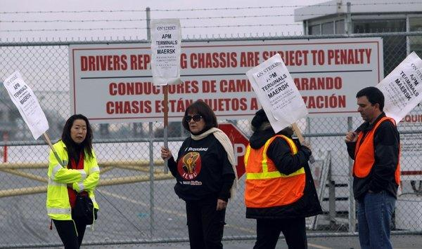 Striking workers picket outside a cargo terminal gate at the Port of Los Angeles. The strike has idled most of the seaport complex in Los Angeles and Long Beach.