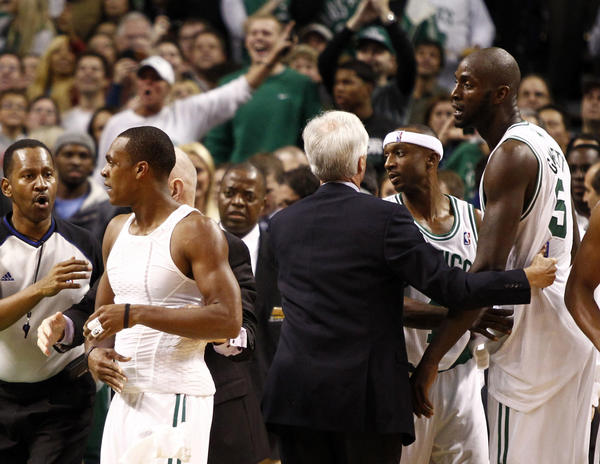 Boston Celtics players including point guard Rajon Rondo (left), power forward Kevin Garnett (right) and shooting guard Jason Terry (second from right) are separated from Brooklyn Nets players after a scrum during the first half at TD Garden.