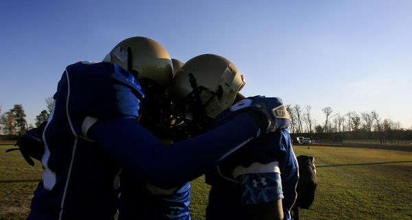 From left to right, Takory Hardy, Kyon Croker and Trevon Batten of smithfield huddle up and reflect over their loss to Courtland after the Region I Division 4 football championship game at Smithfield High School on Saturday, November 24, 2012.