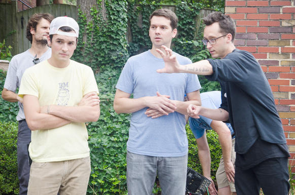 "Director Matt Porterfield (right) goes over a scene with Jeremy Saulnier (center), the director of photography for Porterfield's new film, ""I Used To Be Darker."""