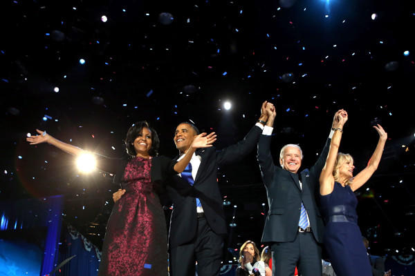 At a rally in McCormick Place in Chicago, the Obamas and Bidens celebrate an election win.