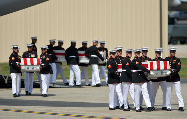 The bodies of four Americans killed in an attack this week in Benghazi, Libya, arrive in caskets at Andrews Air Force Base in Maryland in September.