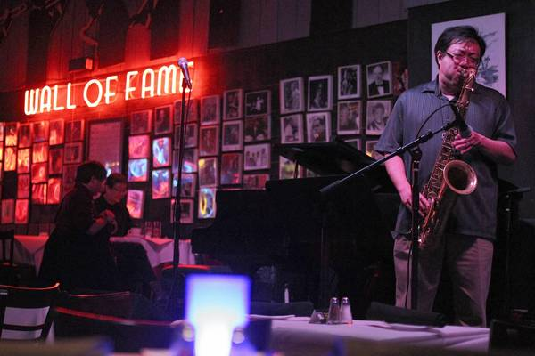 Tenor saxophone player Jeff Chan performs during the Asian American Jazz Festival at Andy's Jazz Club and Restaurant last year.