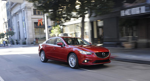 The all-new 2014 Mazda 6 sedan goes on sale in January and will target midsize sedans like the Toyota Camry, Honda Accord and Ford Fusion.