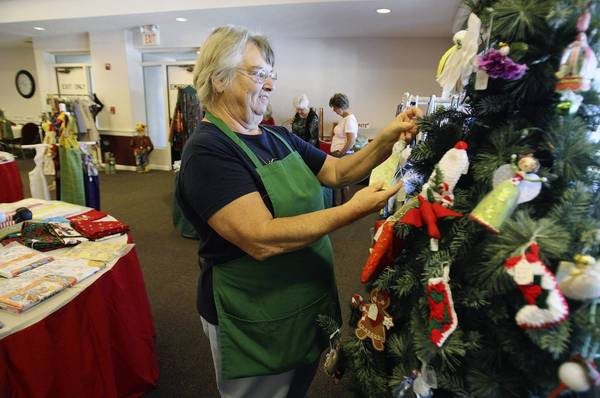 Beverly Bennett looks at Christmas ornaments on Monday, November 26, 2012, at the Eustis Community Center. at 1The Christmas in Eustis 2012 fundraising craft sale is in full swing . The Eustis Historical Museum and Preservation Society in cooperation with the Eustis Facilities and Recreation Department is presenting the annual sale, which runs through Dec. 2. Visitors can find holiday décor and handmade crafts as well as gifts. (Tom Benitez/Orlando Sentinel)
