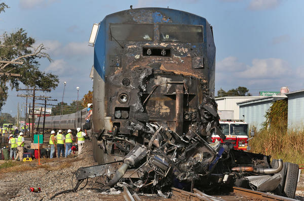 A Miami-bound Amtrak train struck and killed a truck driver at the intersection of Orange Avenue and Nela Avenue.