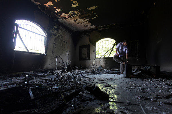 A Libyan man investigates the inside of the U.S. Consulate after an attack that killed four Americans, including Ambassador Chris Stevens, on the night of Sept. 11, in Benghazi, Libya.