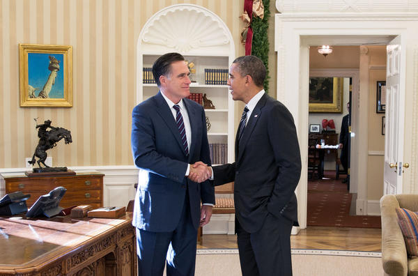 President Barack Obama and former Massachusetts Gov. Mitt Romney talk in the Oval Office following their lunch Thursday in Washington, D.C.