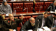 CAIRO -- Egypt's Islamist-dominated constitutional assembly passed a rushed draft of a constitution early Friday to ease public anger against President Mohamed Morsi's expanded powers and preempt an expected court decision to disband it this weekend.