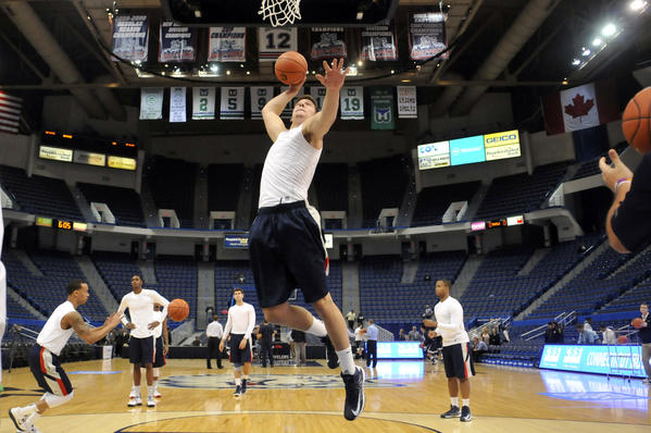 UConn's Tyler Olander warms up before Thursday's game at the XL Center against New Hampshire.