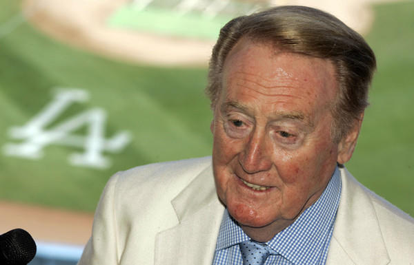 Vin Scully spends his birthday at home reading a book.