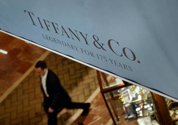 Tiffany & Co. said its third-quarter net income fell nearly 30% because of high material costs and greater-than-expected taxes. Above, a store in Boston.
