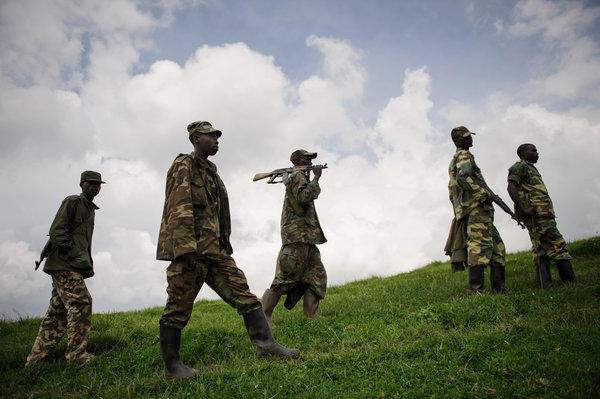 M23 rebels walk in the hills surrounding the town of Mushaki, in the Democratic Republic of Congo.