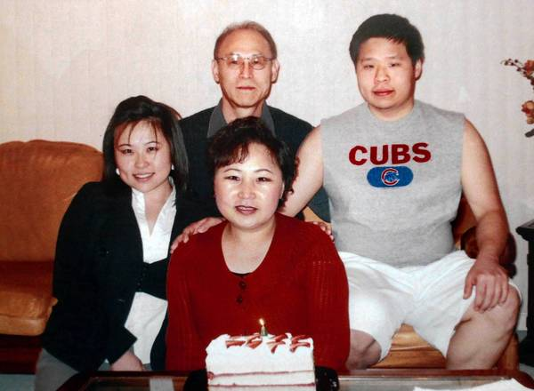 A photo of the Koh family shows, clockwise from left, daughter Helen, father Hyungseok, son Paul and mother Eunsook. Paul died of stab wounds at the family's Northbrook home in April 2009; his father is charged with his death.