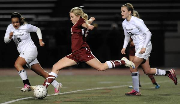 Whitehall #23 Kayla Cunningham is defended by Stroudsburg #6 Mari Cardelle in their District 11 3A girls soccer semifinals held at J. Birney Crum Stadium on Thursday November 1, 2012.