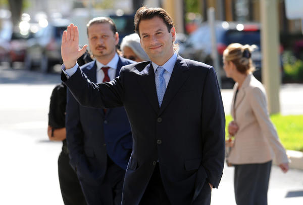 In this December 2011 photograph, Michael Marks waves as he arrives at federal court in West Palm Beach for a hearing. Marks pleaded guilty to a mail and wire fraud conspiracy charge on Nov. 28, 2012. Mark Randall, South Florida Sun Sentinel