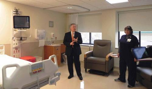 Chambersburg Hospital's Vice President for Administration and Chief Operating Officer John Massimilla leads a tour of the hospital's new $100 million King Street addition on Thursday. During the tour, Massimilla highlighted the spacious rooms with space to accommodate up to seven family members comfortably.