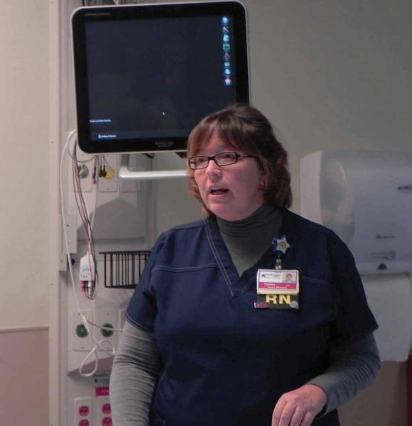 Teresa Napier, critical care nurse manager at Chambersburg Hospital, talks about the benefits of the new private rooms at the hospital during a tour Thursday.
