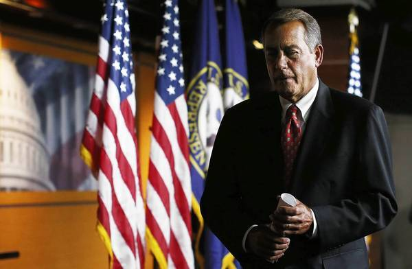 "House Speaker John A. Boehner (R-Ohio) leaves a news conference after expressing disappointment in talks with the Obama administration on avoiding a ""fiscal cliff"" of tax hikes and spending cuts due at the end of the year."