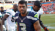 Being short has cost Russell Wilson money, not touchdowns.