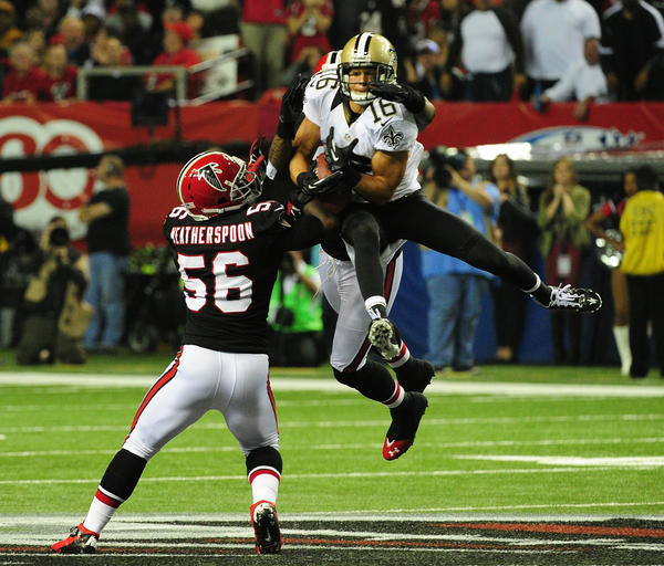 Lance Moore #16 of the New Orleans Saints makes a catch against Sean Weatherspoon #56 of the Atlanta Falcons at the Georgia Dome on November 29, 2012 in Atlanta, Georgia. Atlanta won 23–13.