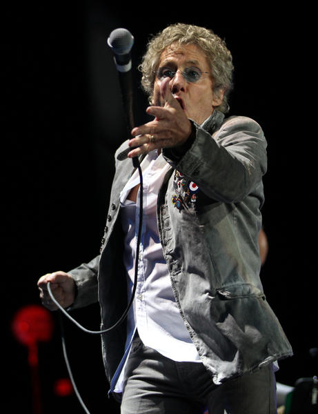 The Who's Roger Daltrey catches his microphone during the band's show at the Allstate Arena in Rosemont on Thursday, November 29, 2012.
