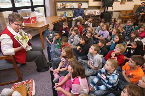 "South Dakota first lady Linda Daugaard, left, reads ""Mudgy & Millie"" by Susan Nipp to a group of third graders at O.M. Tiffany Elementary School on Thursday. Daugaard made stops at three Aberdeen public elementary schools Thursday and will visit another two more today."