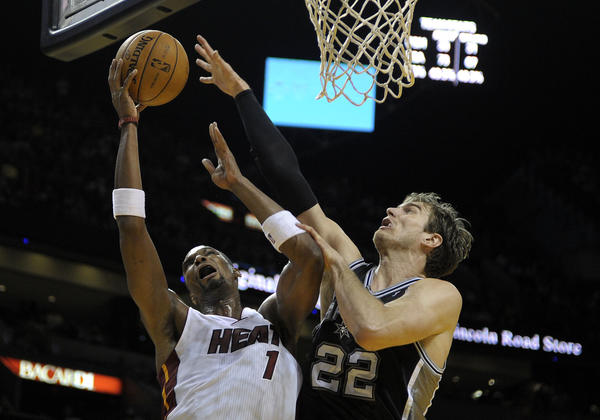 Miami Heat forward Chris Bosh scores on San Antonio Spurs forward Tiago Splitter during the fourth quarter of their game.