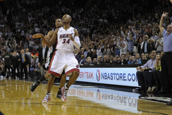 Miami Heat guard Ray Allen hits a three point shot during the fourth quarter against the San Antonio Spurs.
