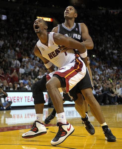 Miami Heat forward Chris Bosh boxes out San Antonio Spurs forward Boris Diaw during the fourth quarter of their game.