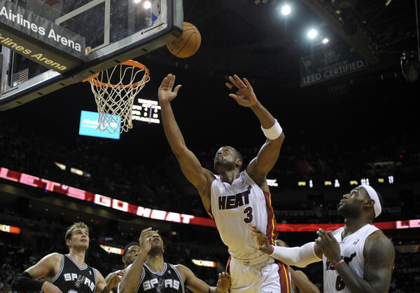 Miami Heat guard Dwyane Wade reaches for the ball during the fourth quarter against the San Antonio Spurs.