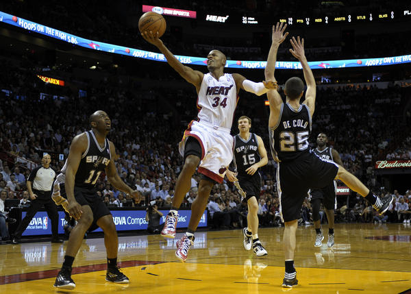 Miami Heat guard Ray Allen scores during the fourth quarter against the San Antonio Spurs.