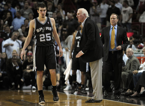 On November 29th, San Antonio's coach Gregg Popovich faced the Heat in Miami without stars Tim Duncan, Tony Parker and Manu Ginobili. In the photo, coach Popovich complains to Nando De Colo during the second half of their game against the Miami Heat. Miami won 105-100.